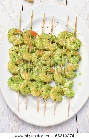 Shrimp in pesto sauce prepared for grilling