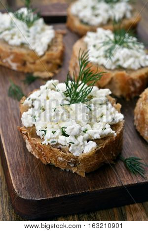 Healthy food sandwich with wholegrain bread curd cheese and dill