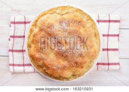 Apple pie on white wooden background top view
