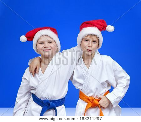 Two boys in caps of Santa Claus