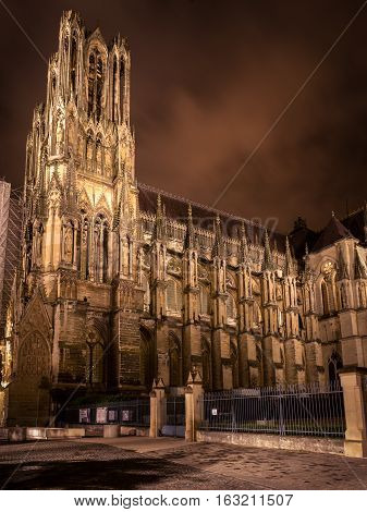 Lateral part of Reims cathedral at night illumination, France