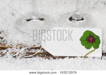 Greeting card with cloverleaf and sparkling wine