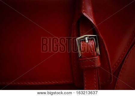 Red glossy female leather bag. With deep shadows