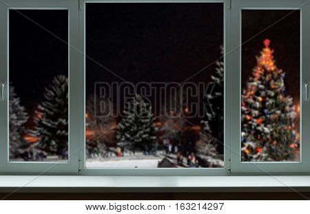 Outside of the large window nice Christmas landscape