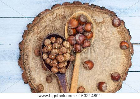 nuts hazelnuts in a wooden spoon in the shell and shelled fruits