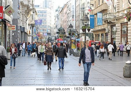 BELGRADE SERBIA - October 24: Walking street Kneza Mihaila with people looking around and shopping in Belgrade Serbia - October 24 2016; Shopping district with many shops and people walking around in city centre.