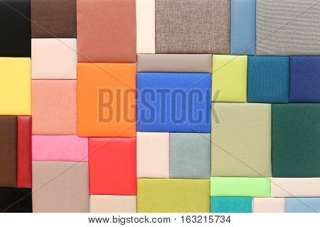 Bunch of upholstery materials textures samples on wall