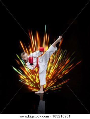 Boy beats a kick against a bright background