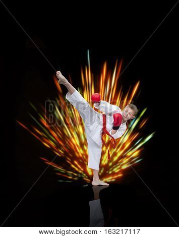 The athlete beats a kick in the background with bright rays