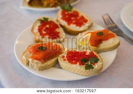 sandwiches with red caviar and red fish