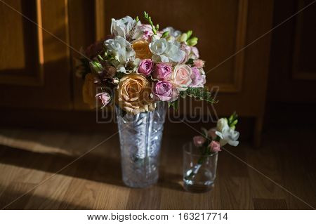 wedding bouquet of yellow roses pink and white roses purple flowers wedding boutonniere of pink roses and white flower