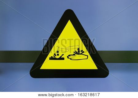 Focus at label corrosive chemicals.Hazard symbol or warning sign