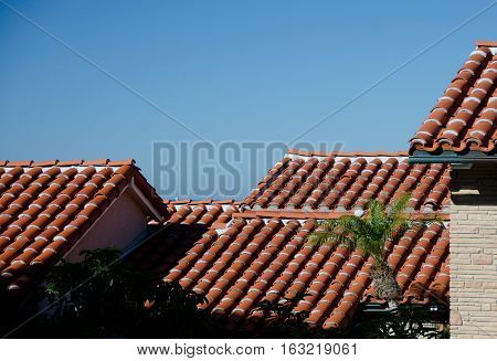 Red Tile Roofs Framing A Patio In A Beach Resort