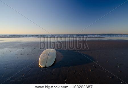 Surfboard Casting  Tall Shade At Sunset Near La Jolla Cave