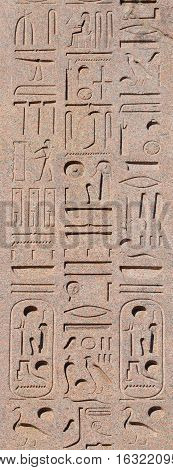 Hieroglyph script on ancient egyptian obelisk erected in the center of Rome built during Pharaoh Ramses II reign