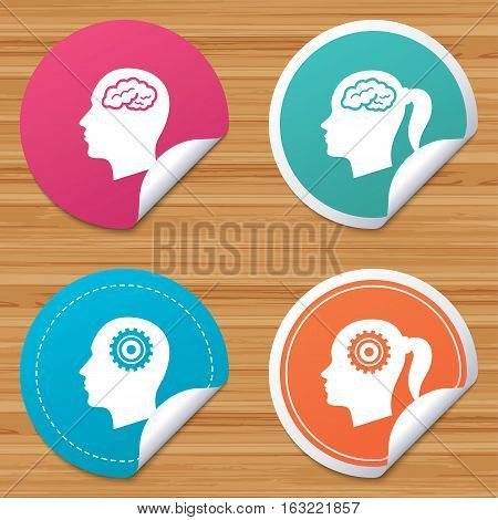Round stickers or website banners. Head with brain icon. Male and female human think symbols. Cogwheel gears signs. Woman with pigtail. Circle badges with bended corner. Vector