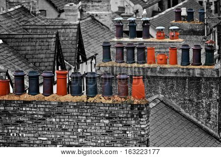 Painted colorful chimneys on the roof in Wales, England