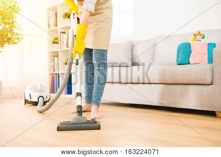 Woman Use Vacuum Cleaner To Cleaning