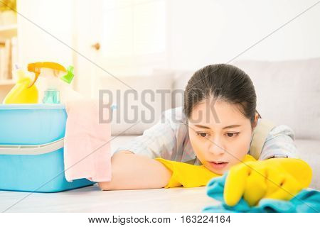 Tired Woman Holding Rab With Detergents