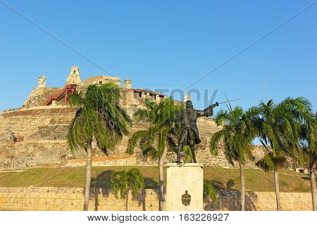 Statue of wounded General Blas in front of San Felipe de Barajas fortress at sunset. Legendary bastion is a landmark of Cartagena Colombia.