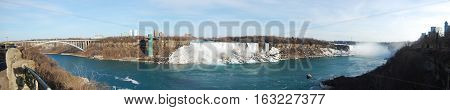 Niagara Falls panorama including Rainbow Bridge, American Falls and Horseshoe Falls from left to right, Niagara Falls, New York State, USA.