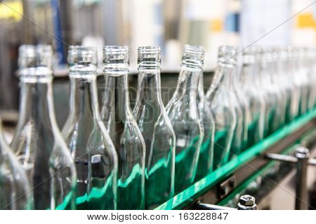 The Bottles On The Conveyor Belt At The Plant For Bottling Of Al