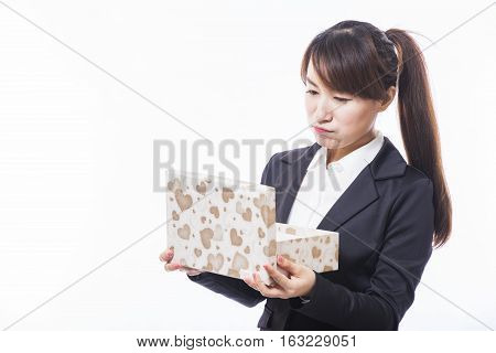 business woman opening gift disappointed and unhappy