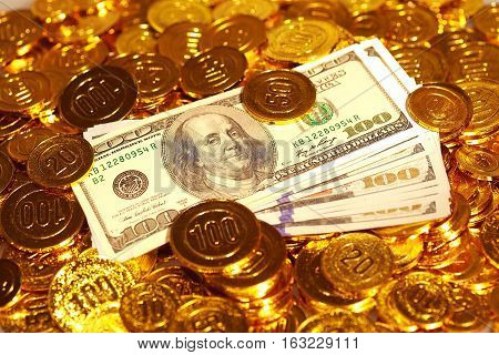 Dollar Bills In Golden Coins Heap