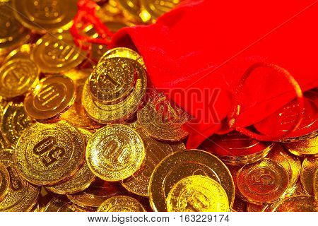 From Red Sack Scattered Pile Of Gold Coins
