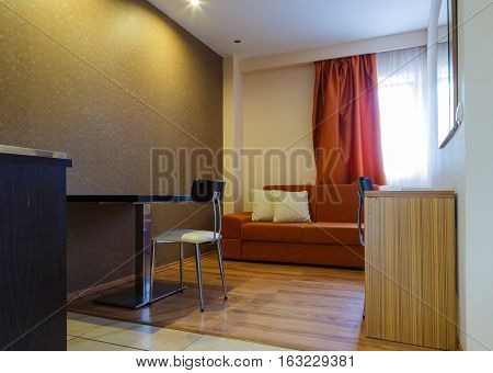 Couch and wooden table in the modern room