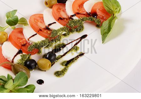 Tomatoes And Mozzarella Cheese Sliced Olives