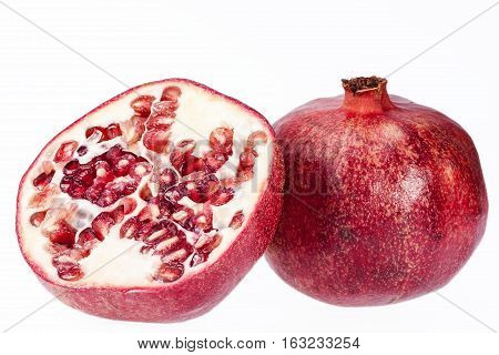 Fruit of red pomegranate isolated on white background close up.