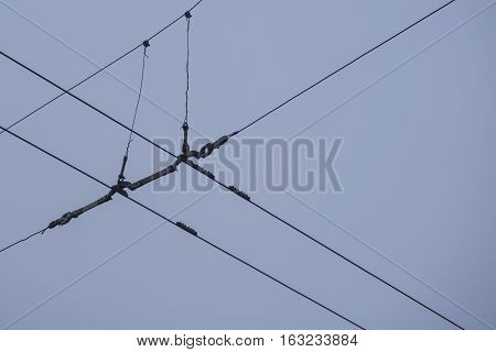 Trolley-bus electric wire. Electro contact unite the bridge at opening closing