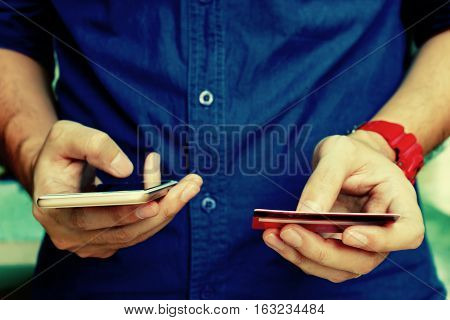 Young Man Holding Credit Card And Using Smart Phone With Shopping Online. Online Payment Concept.