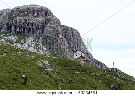 Sexten, Italy - August 2, 2016: Mountain panorama and alpine Hut Zsigmondyhutte in Sexten Dolomites. The Zsigmondyhutte is a mountain hut on the rock ridge of the Zwolferkofel. The hut is named after the Viennese alpinist Emil Zsigmondy.