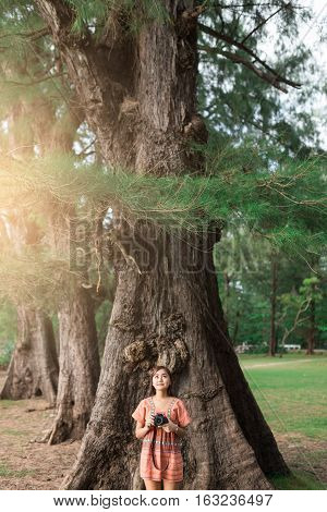 Beautiful Girl Leaning Against Tree In The Morning.
