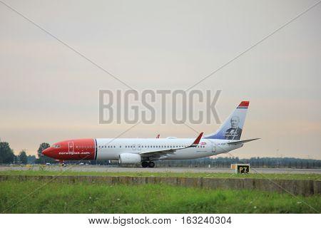 Amsterdam The Netherlands - August 9 2015: LN-NGP Norwegian Air Shuttle Boeing 737-800 taxing to the Polderbaan runway