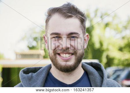 portrait of expressive bearded young adult outdoor