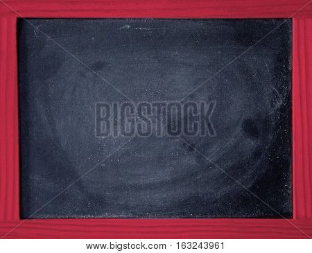a black chalkboard and a red wooden frame