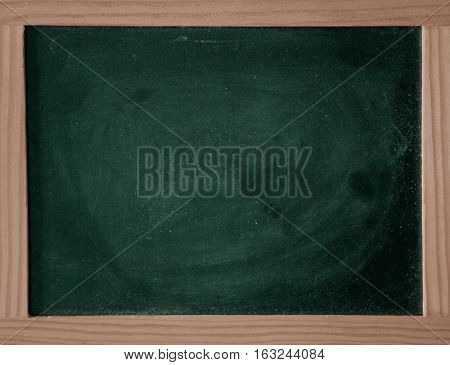 green chalkboard and a brown  wooden frame