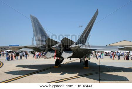The fighter F-22 displayed at an air show poster