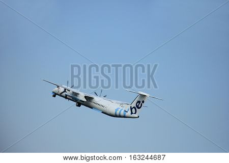 Amsterdam The Netherlands - June 12 2015: G-JECL Flybe De Havilland Canada DHC-8 takes of from Amsterdam Airport Polderbaan runway.