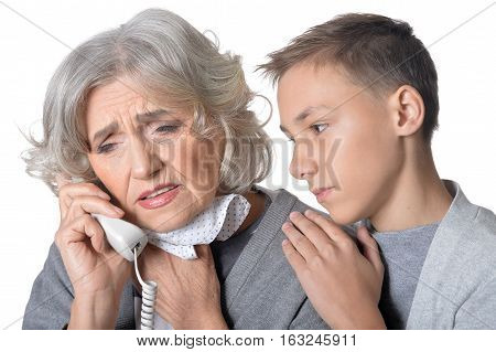 Portrait of senior woman recieved bad news and grandson trying to cheer her up