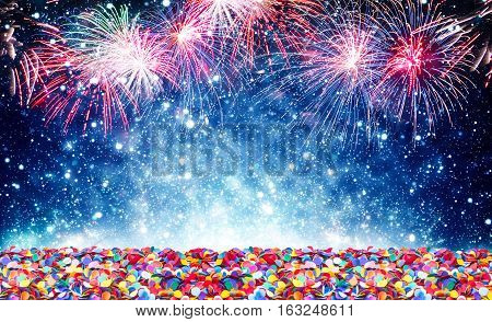 Blue glowing background with fireworks and confetti