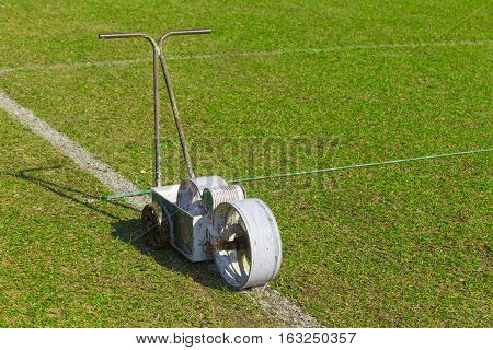 football or soccer field paint roller tool using to paint white lines on the filed