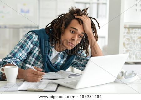 Portrait of mixed race businessman working in the office
