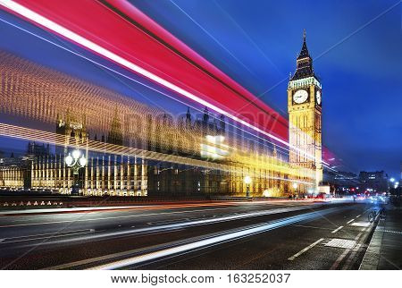 Big Ben one of the most prominent symbols of both London and England as shown at night along with the lights of the cars passing