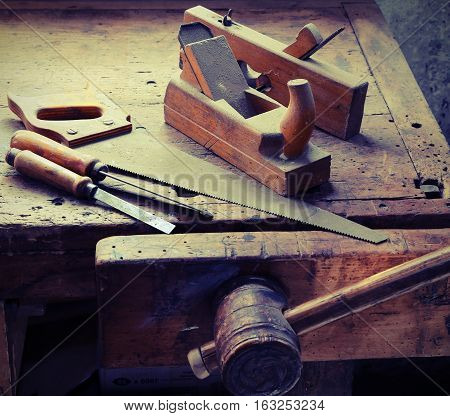 Saw chisel and bitten in the ancient workshop of the carpenter