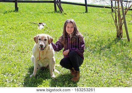 Cute Little Girl With Labrador Retriever Dog