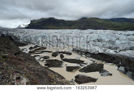 Skaftafell glacier in Iceland. Snowy landscape. Summer.